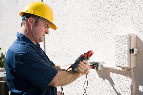 Electrician Safely Checking Voltage